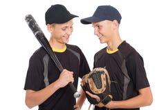 Individuos de los hermanos gemelos bajo la forma de juego de béisbol Imágenes de archivo libres de regalías