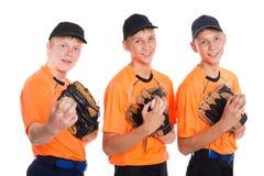 Individuos en la forma de un juego de béisbol Foto de archivo