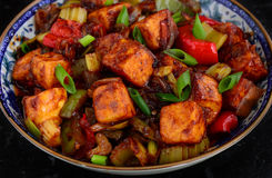 Indo-Chinese starter -Paneer Manchurian. Spiced cottage cheese cooked in fusion with Chinese soy and sweet chilli sauces Stock Photo