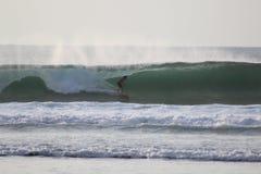 Indo wave- balangan beach surf religion stock image