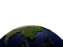 Indochina bij nacht op model van Aarde met in reliëf gemaakt land Royalty-vrije Stock Afbeelding