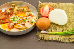 Indochina pan-fried egg with garnish (tomatoes , chili ,pepper , Stock Photography