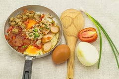 Indochina pan-fried egg with garnish (tomatoes , chili ,pepper , Stock Images