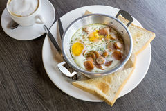 Indochina pan fried egg with toppings and cappuccino coffee, Bre Royalty Free Stock Image
