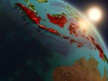 Indonesië van ruimte tijdens zonsopgang Stock Foto
