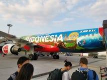 Indonesia AirAsia plane body. Flight, aeroplane, airplane, airport, passengers stock photography