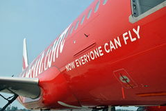 Indonesia AirAsia Tagline. Tagline of Indonesia AirAsia Now Everyone Can Fly painted on one of its Airbus A320 Stock Photos