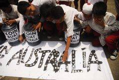 INDONESIA AUSTRALIA WORSENED RELATION. School children are attending Coins For Australia rally, to repay Australian humanitarian aid on Aceh Tsunami Disaster in Royalty Free Stock Photography