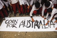 INDONESIA AUSTRALIA WORSENED RELATION. School children are attending Coins For Australia rally, to repay Australian humanitarian aid on Aceh Tsunami Disaster in Royalty Free Stock Image