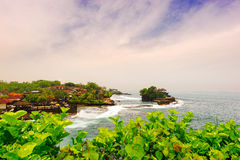 Bali Tanah Lot. Indonesia Bali island.Tanah Lot is the landmark building in bali island.It located on the seashore,the high tide will partly submerged Stock Photo