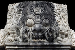 Indonesia, bali: sculpture of kala. Stone sculpture of head's kala; traditionally represented in the top of the front door; a protective image against the royalty free stock images