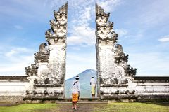 Indonesia - Bali - tourist standing betwen Lempuyang gate Stock Images