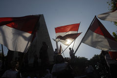 INDONESIA CHILDREN MALNUTRITION PROBLEM. Children carry Indonesian flag The Red and White in Solo, Java, Indonesia. Nutritional problems in Indonesia is still a Stock Images