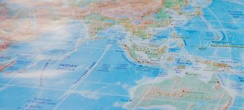 Indonesia in close up on the map. Focus on the name of country. Vignetting effect.  royalty free stock photos
