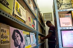 INDONESIA CURRENCY FALL. Librarian are inspecting musical archive on Lokananta Music Studio in Solo, Java, Indonesia. Indonesia's Rupiah declines to weakest Royalty Free Stock Photo