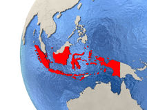 Indonesia on 3D globe. Map of Indonesia on globe with watery blue oceans and landmass with visible country borders. 3D illustration Stock Photos