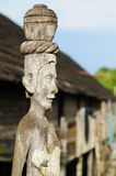Indonesia - Dayak tribal culture. Traditional Dayak tribal culture. Detail Dayak (wooden totem) house - longhouse in Borneo. East Kalimantan, Indonesia Royalty Free Stock Images