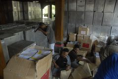 INDONESIA DEMOCRACY OBSTACLE. Worker prepares ballot papers for legislative election at Solo, Java, Indonesia. Indonesia's huge plan to hold simultaneous local royalty free stock photo