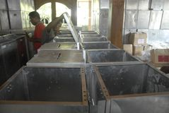 INDONESIA DEMOCRACY OBSTACLE. Worker prepares voting boxes for legislative election at Solo, Java, Indonesia. Indonesia's huge plan to hold simultaneous local royalty free stock photos