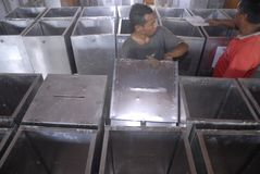INDONESIA DEMOCRACY OBSTACLE. Worker prepares voting boxes for legislative election at Solo, Java, Indonesia. Indonesia's huge plan to hold simultaneous local royalty free stock photo