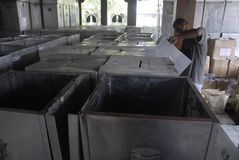 INDONESIA DEMOCRACY OBSTACLE. Worker prepares voting boxes for legislative election at Solo, Java, Indonesia. Indonesia's huge plan to hold simultaneous local stock photography