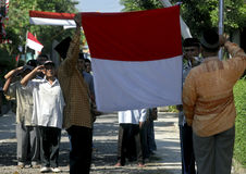 INDONESIA FLAG CEREMONY. Villagers give salute to Indonesian National Flag, Sang Dwi Warna, at rural area of Karanganyar, Java, Indonesia Royalty Free Stock Photo