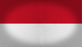 Indonesia flag. Composed by two horizontal lines, one in red at the top and another in pure white in the bottom of it, fabric texture background vignette Royalty Free Stock Photos