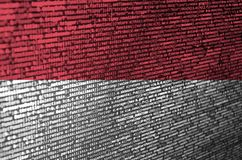 Indonesia flag is depicted on the screen with the program code. The concept of modern technology and site development.  royalty free stock images