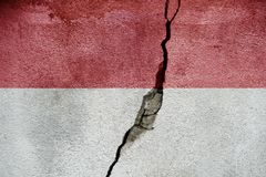 Indonesia FLAG PAINTED ON CRACKED WALL cool stock photos
