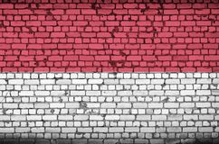 Indonesia flag is painted onto an old brick wall royalty free illustration