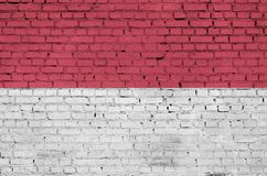 Indonesia flag is painted onto an old brick wall royalty free stock photography