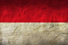 Indonesia Flag on Paper. Flag on an old Paper Texture Royalty Free Stock Images