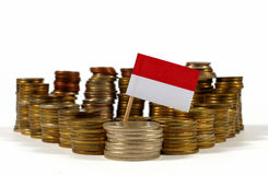 Indonesia flag with stack of money coins Royalty Free Stock Image