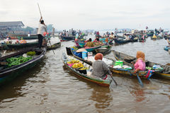 Indonesia - floating market in Banjarmasin. Banjarmasin - Kalimantan's largest and most beguiling city rest gingerly over a labyrinth of canals. Floating market Royalty Free Stock Photo