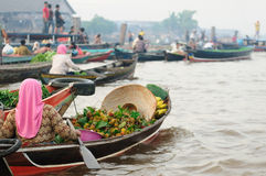 Indonesia - floating market in Banjarmasin. Banjarmasin - Kalimantan's largest and most beguiling city rest gingerly over a labyrinth of canals. Floating market Royalty Free Stock Photos