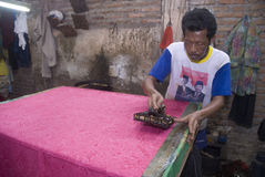 INDONESIA FOREIGN EXCHANGE RESERVE SCRUTINY. A smog batik workshop in Solo, Java, Indonesia. Indonesia's foreign-exchange reserves, the smallest in Southeast Stock Images