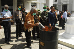 INDONESIA GLOBAL OIL PRICES HIT ECONOMY. Law enforcement officers are destroying counterfeit Rupiah money in Solo, Java, Indonesia. The Southeast Asia's largest stock photography