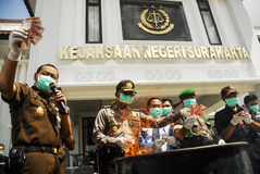 INDONESIA GLOBAL OIL PRICES HIT ECONOMY. Law enforcement officers are destroying counterfeit Rupiah money in Solo, Java, Indonesia. The Southeast Asia's largest royalty free stock image