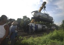 INDONESIA GLOBAL OIL PRICES HIT ECONOMY. A slipped oil railway train in Solo, Java, Indonesia. The Southeast Asia's largest economy has been hit by weak global royalty free stock photography