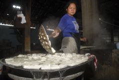INDONESIA GLOBAL OIL PRICES HIT ECONOMY. A tofu making home industry in Solo, Java, Indonesia. The Southeast Asia's largest economy has been hit by weak global royalty free stock photography