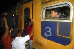 INDONESIA GLOBAL OIL PRICES HIT ECONOMY. Train passengers in Solo, Java, Indonesia. The Southeast Asia's largest economy has been hit by weak global oil and stock image
