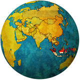 Indonesia on globe map. Isolated over white territory of indonesia with flag on globe map Stock Photos