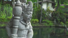 Indonesia god statue in front Bali temple, Indonesia. Traditional indonesian hindu symbol. Ancient sculpture religious. Idol. Balinese spiritual architecture stock video