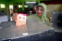 INDONESIA HIGH COST DEMOCRACY. A citizen votes on a local regent election in Karanganyar, Java, Indonesia. Since the fall of Suharto militaristic regime in 1998 stock image
