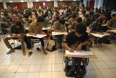 INDONESIA HIGHER EDUCATION TOWARD RESEARCH. Participants taking national university entrance test in Solo, Java, Indonesia. The new Indonesian administration royalty free stock photo