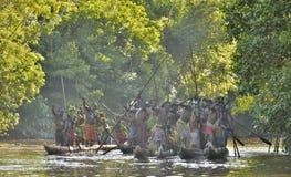 Canoe war ceremony of Asmat people. Headhunters of a tribe of Asmat. INDONESIA, IRIAN JAYA, ASMAT PROVINCE, JOW VILLAGE - MAY 23: Canoe war ceremony of Asmat Stock Image