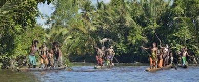 Canoe war ceremony of Asmat people. Headhunters of a tribe of Asmat. INDONESIA, IRIAN JAYA, ASMAT PROVINCE, JOW VILLAGE - MAY 23: Canoe war ceremony of Asmat Stock Photography