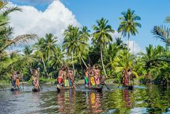 Canoe war ceremony of Asmat people. Headhunters of a tribe of Asmat. INDONESIA, IRIAN JAYA, ASMAT PROVINCE, JOW VILLAGE - MAY 23: Canoe war ceremony of Asmat Royalty Free Stock Image