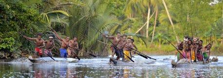 Canoe war ceremony of Asmat people. Headhunters of a tribe of Asmat. INDONESIA, IRIAN JAYA, ASMAT PROVINCE, JOW VILLAGE - MAY 23: Canoe war ceremony of Asmat Royalty Free Stock Images