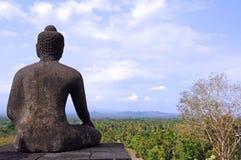 Indonesia, java, Borobudur: sunrise. Indonesia, java, Borobudur: a beautifull stone seat buddha in meditation facing to the sunrise at the most famous asiatic stock image